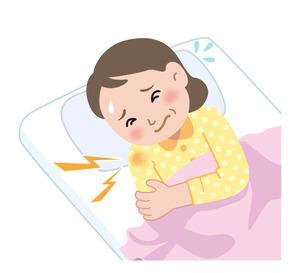 肩を痛がりながら寝ている女性